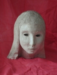 white ceramic goddess mask